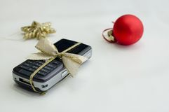 Cell phone and christmas ball Stock Photography