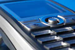 Cell Phone Closeup. Cellphone on blue background macro Stock Photography