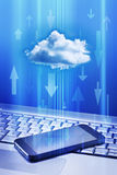 Cell Phone Cloud Technology. A cell phone and laptop with a cloud and data arrows Royalty Free Stock Photo