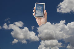 Cell phone in clouds Royalty Free Stock Image