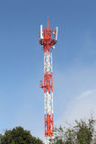 Cell phone and communication towers against blue sky Stock Photography