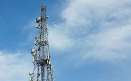 Cell phone communications tower against blue sky Stock Photo