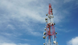 Cell phone communications tower against blue sky. Cell phone communications antennas tower against blue sky Stock Photos