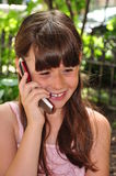 Cell Phone Conversation. A beautiful young girl is talking on the cell phone royalty free stock photos