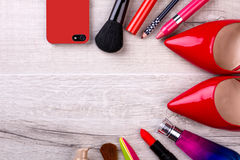 Cell phone, cosmetics and shoes. Stock Photography