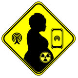 Cell Phone danger to unborn child. Wi-Fi exposure and wireless radiation can harm the unborn baby Stock Image