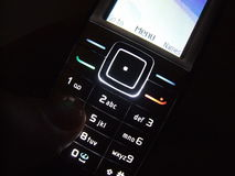 Cell phone in dark. Mobil phone in dark with light keypad stock photography