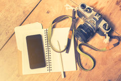Cell phone, diary and camera Stock Images