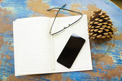 Cell phone, diary and glasses Stock Photo