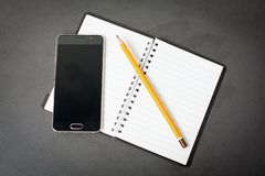 Cell phone with diary. Notebook, and pencil royalty free stock photos