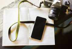 Cell phone, diary and old photo camera Royalty Free Stock Images
