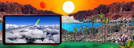 Cell phone displaying aircraft wing and cloudy sky on background of fantastic landscape with sun, red moon, rocks, light house,. Concept of traveling and royalty free stock photos