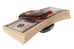 Cell phone and dollars Royalty Free Stock Images