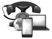 Cell phone, earth globe, laptop and rotary phone Stock Photos