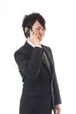 Cell-phone ed uomo d'affari Immagine Stock