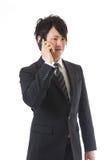 Cell-phone ed uomo d'affari Fotografia Stock