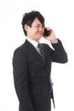 Cell-phone ed uomo d'affari Fotografie Stock Libere da Diritti