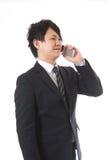 Cell-phone ed uomo d'affari Fotografia Stock Libera da Diritti