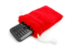 Cell phone in fluffy pouch. Isolated Royalty Free Stock Image