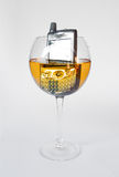 Cell phone in a glass of white wine Stock Photos