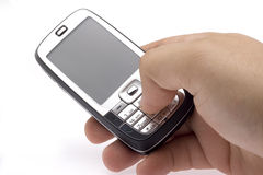Cell phone in a hand. Flat cell phone in hand Royalty Free Stock Photos
