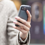 Cell phone in hand Stock Photography