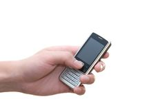 Cell phone in hand. On white background stock photos