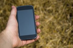 Cell phone in hand Royalty Free Stock Photo