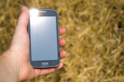 Cell phone in hand Royalty Free Stock Image