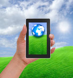 Cell phone in hand and country view Royalty Free Stock Image