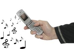 Cell phone in a hand & music 2. The hand that insurance one cell phone & music, in deep black Royalty Free Stock Photo