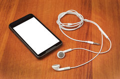 Cell phone and headphones Royalty Free Stock Image