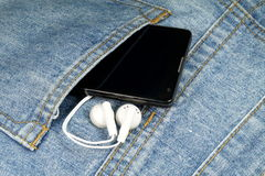 A cell phone and headphones Royalty Free Stock Photo