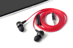 Cell phone and headphones Royalty Free Stock Photo