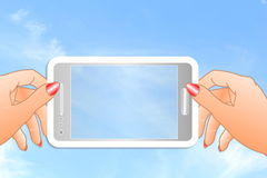 Cell phone icon in hand in sky background Royalty Free Stock Photography
