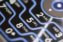Cell phone keypad. The numbers and letters of a backlit cellphone keypad royalty free stock image