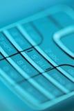 Cell phone keypad. In blue light. Short depth of field Stock Image
