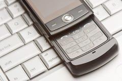 Cell Phone on Laptop Macro Stock Photo