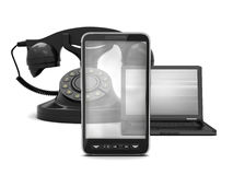 Cell phone, laptop and retro rotary phone Royalty Free Stock Photos