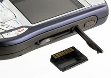 Cell phone and memory card. Mobile phone and memory card royalty free stock photo