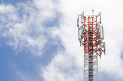 Cell Phone Mobile Tower in blue sky with clouds. Top of Cell Phone Mobile Tower with blue sky and clouds in background Stock Photography
