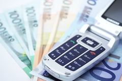 Cell phone and money. On white background Stock Photos
