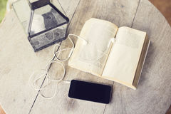 Cell phone and open book Royalty Free Stock Images