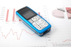 Cell phone over business chart Stock Photo