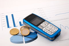 Cell phone over business chart Stock Image