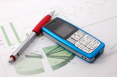 Cell phone over business chart Royalty Free Stock Image