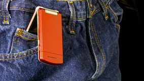 Cell phone in a pair of jeans Stock Photography