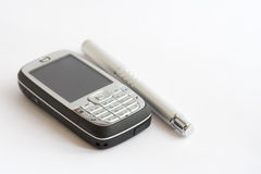 Cell phone & pen Royalty Free Stock Images