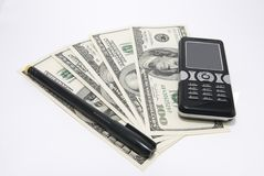 Cell phone, pen and money Stock Photography