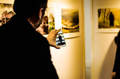 Cell Phone On Photography Exhibition Royalty Free Stock Photography